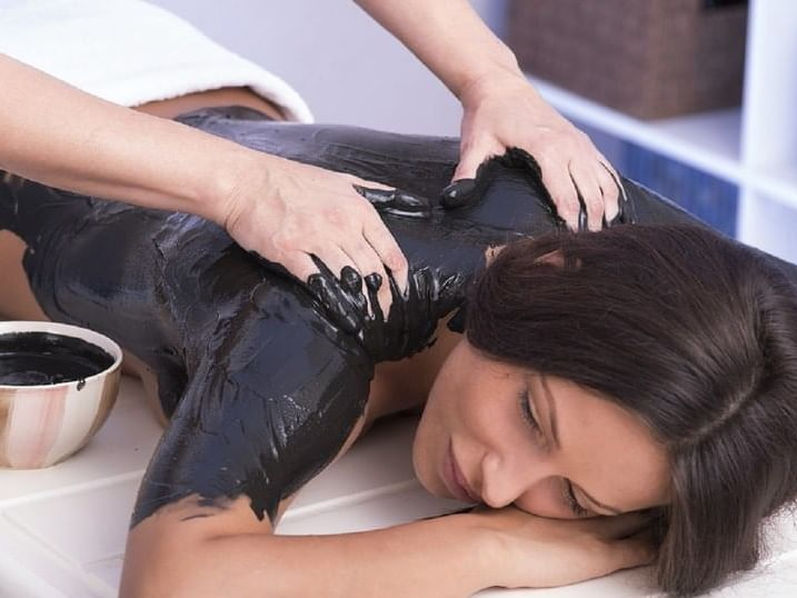 A lady getting a mud treatment in the spa at Ana Hotels Europa