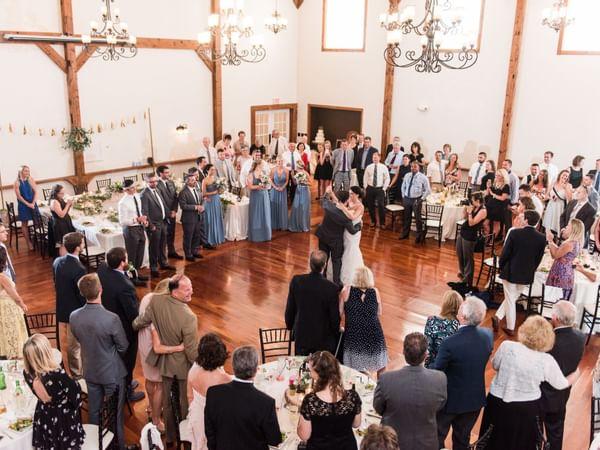 Newlyweds dancing at wedding reception.