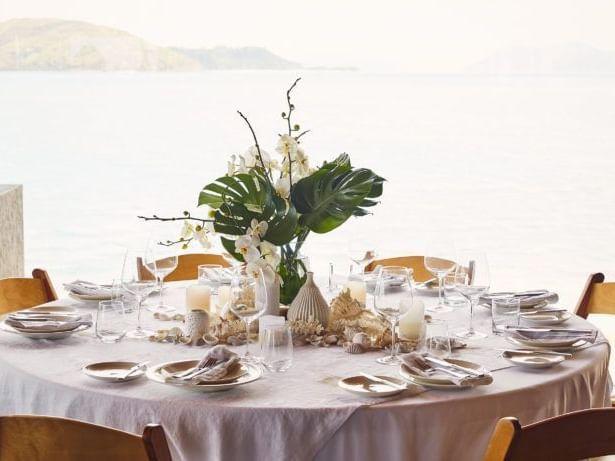 Arranged dining table in restaurant at Daydream Island Resort