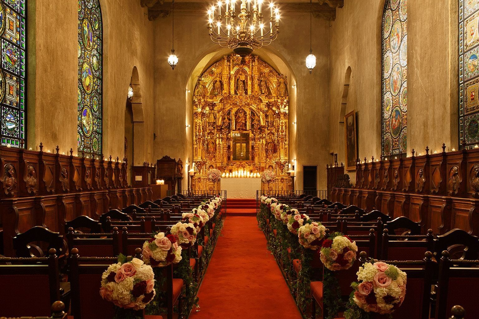 St. Francis of Assisi chapel with flowers decorating the aisle