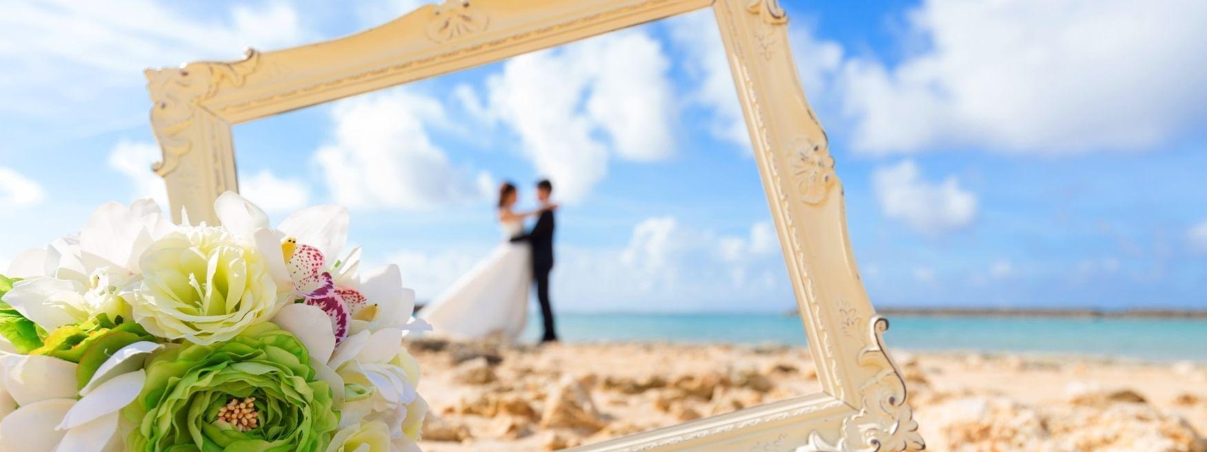 Couple having a photoshoot on beach at Daydream Island Resort