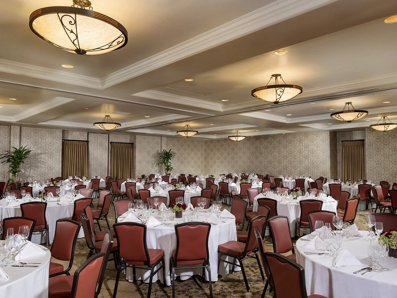 Ballroom with round tables set for dining