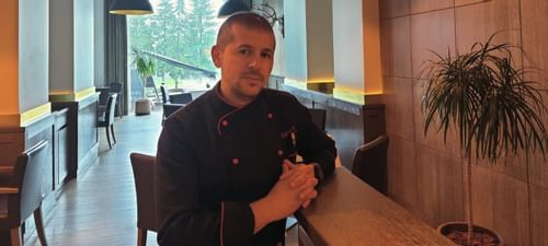 A Chef Posing at Ana Hotels in Romania