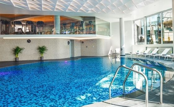 An Indoor hotel pool at Ana Hotels in Romania