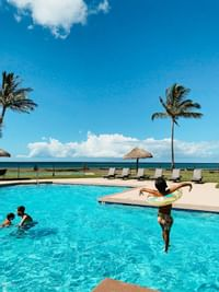 kid jumping into the swimming pool at Waimea Plantation Cottages