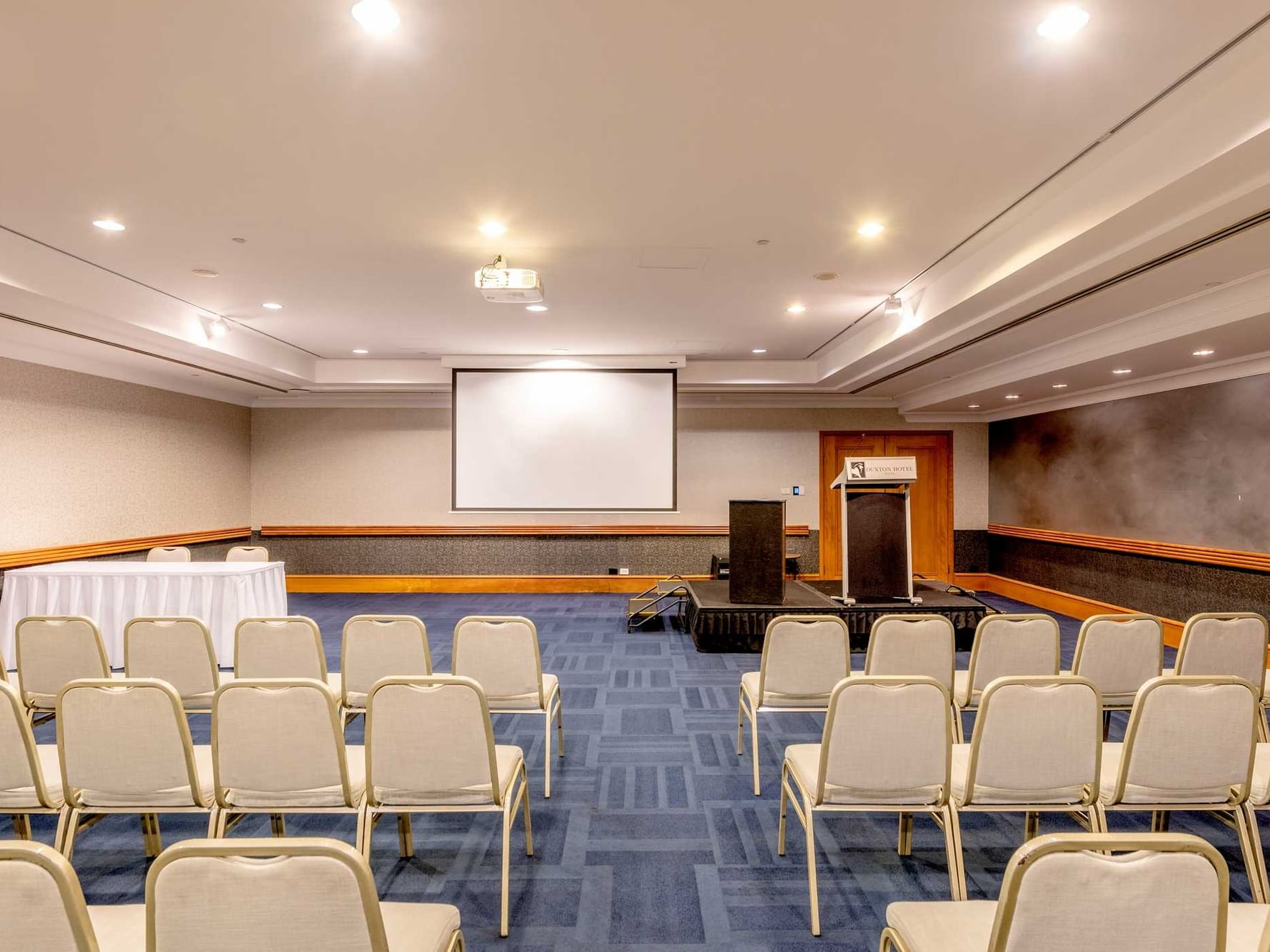 Meeting Room arranged with white chairs at  Duxton Hotel Perth