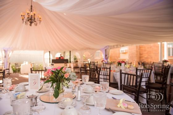 outdoor tent with tables and chairs set elegantly