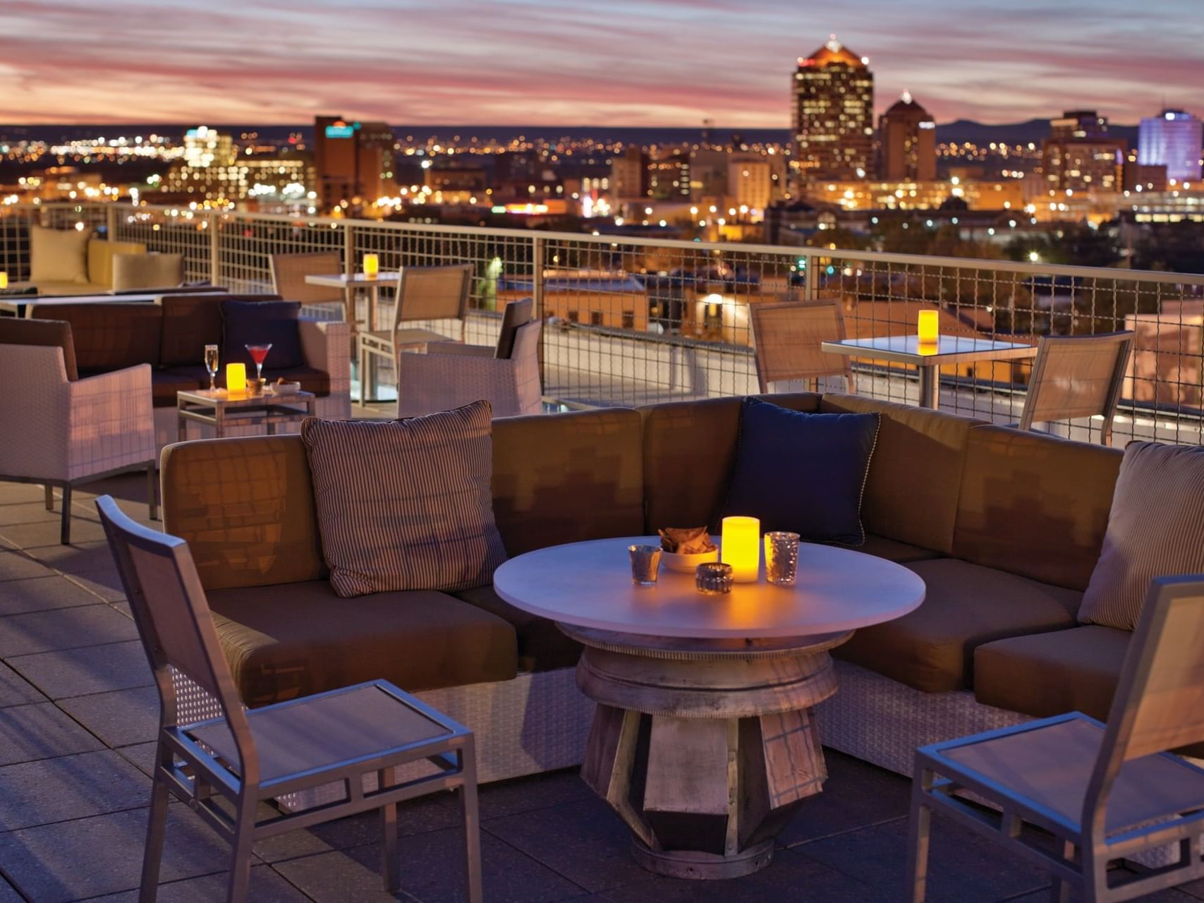 Lounge seats at rooftop restaurant overlooking city