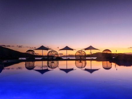 Pool deck at sunset at Daydream Island Resort