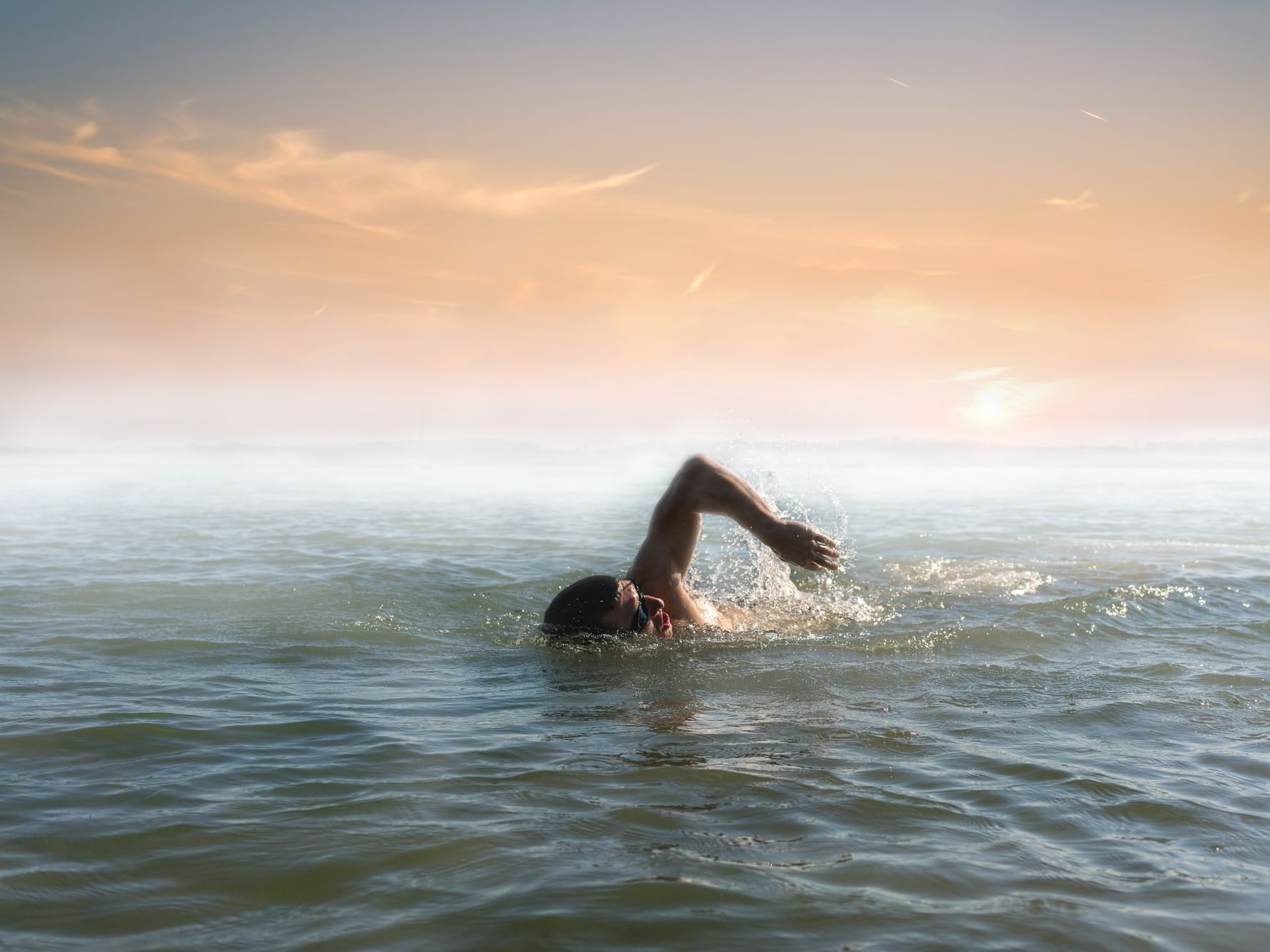 Person swim in open water near Daydream Island Resort