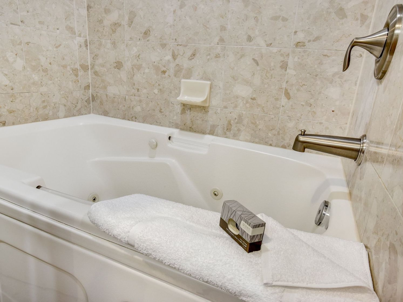 suite bathroom at grove hotel