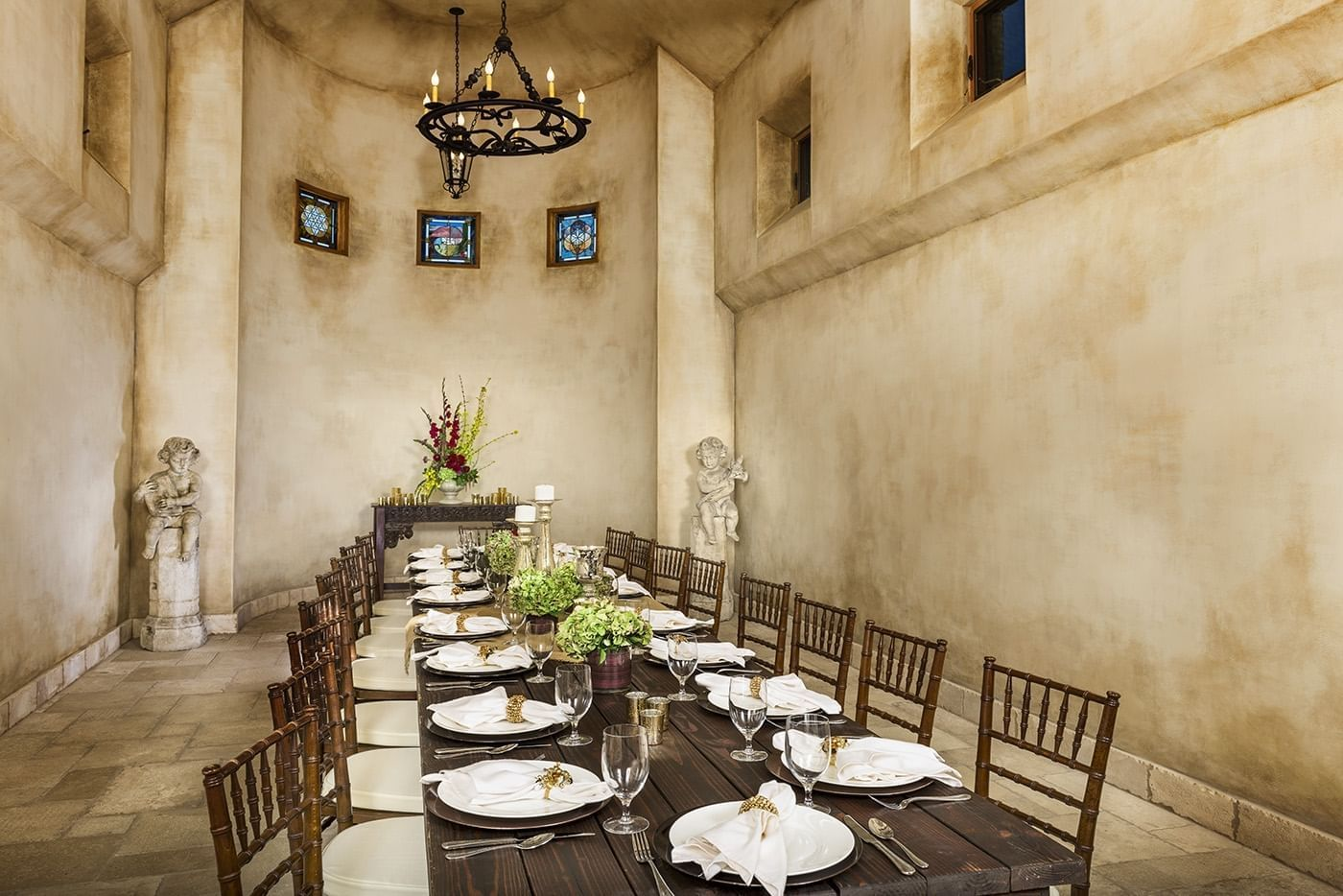 Private dining room area with a long wooden table set for dining