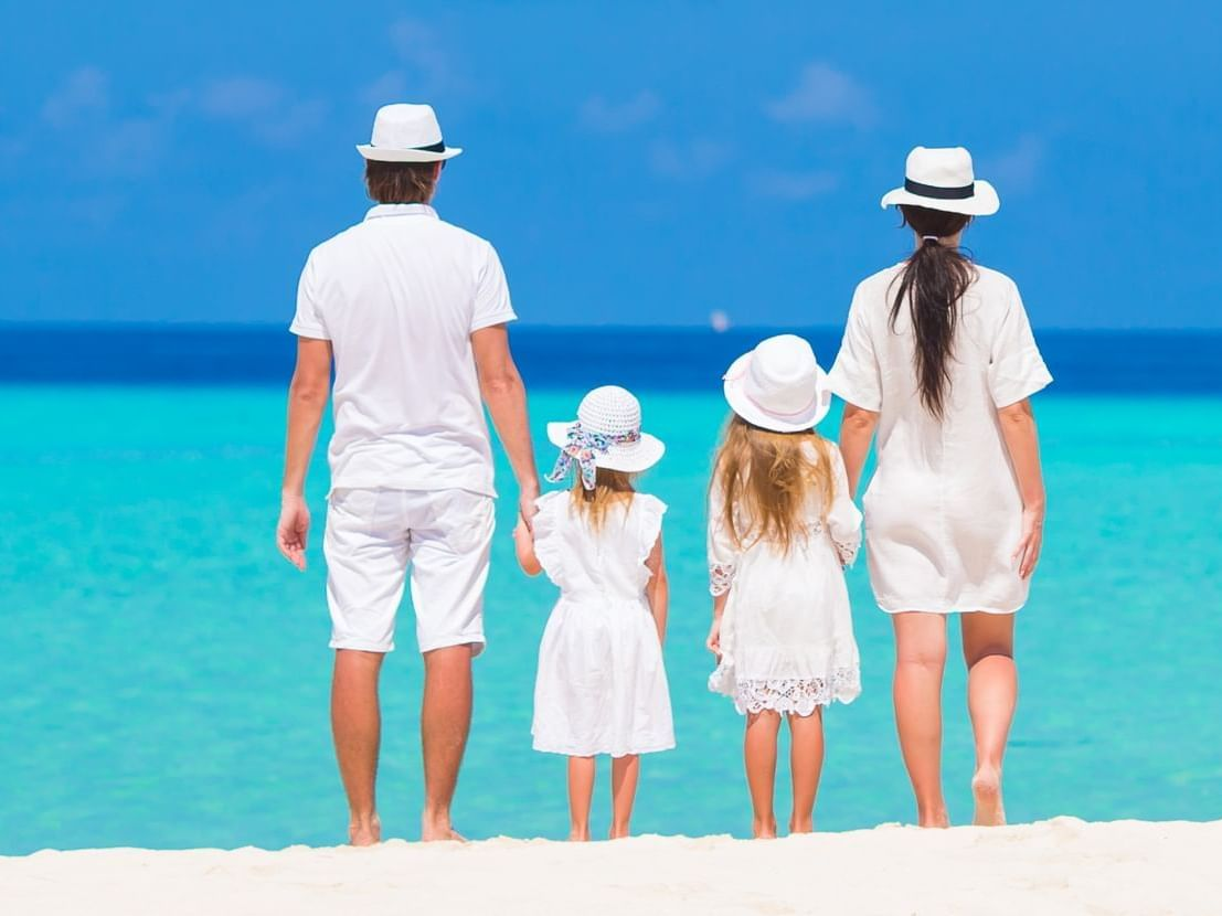 Family watching ocean from beach at Daydream Island Resort
