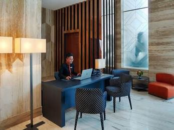 reception desk in lobby area with cushion seating