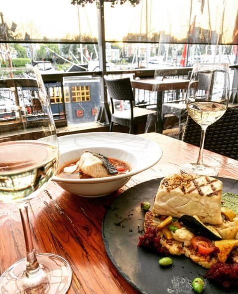 Delicious Grilled fish & wine at Granville Island Hotel