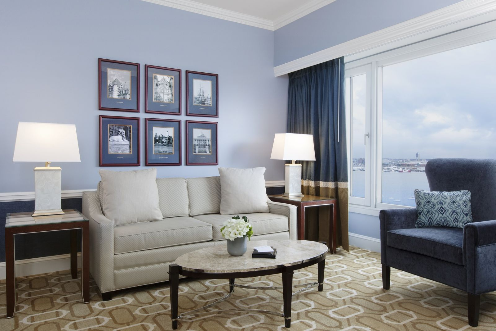 Hotel suite living room with Boston Harbor view