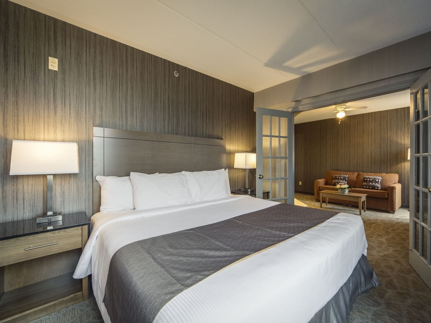 Double bed with couch and Coffee table - Monte Carlo Inn Airport Suites