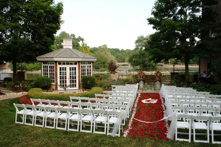 chairs and roses at outdoor wedding reception