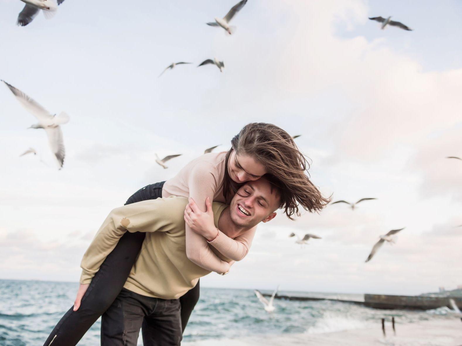A couple having fun on the beach near Ana Hotels Europa