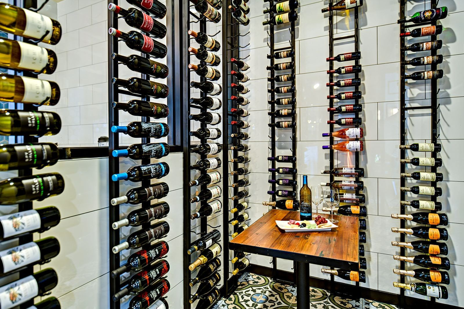 wine bottles hanging on a wall