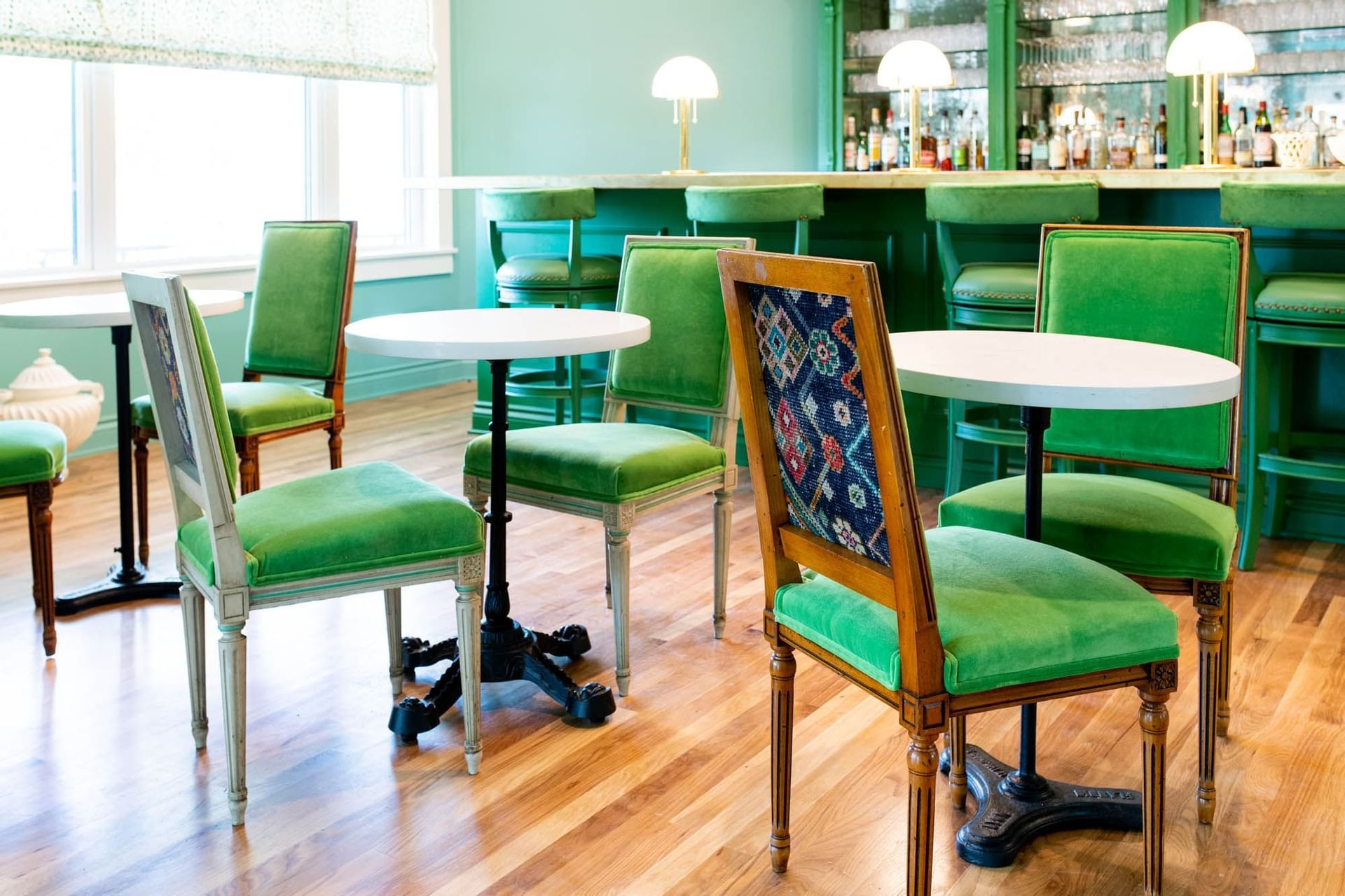 green chairs at bar in blue room