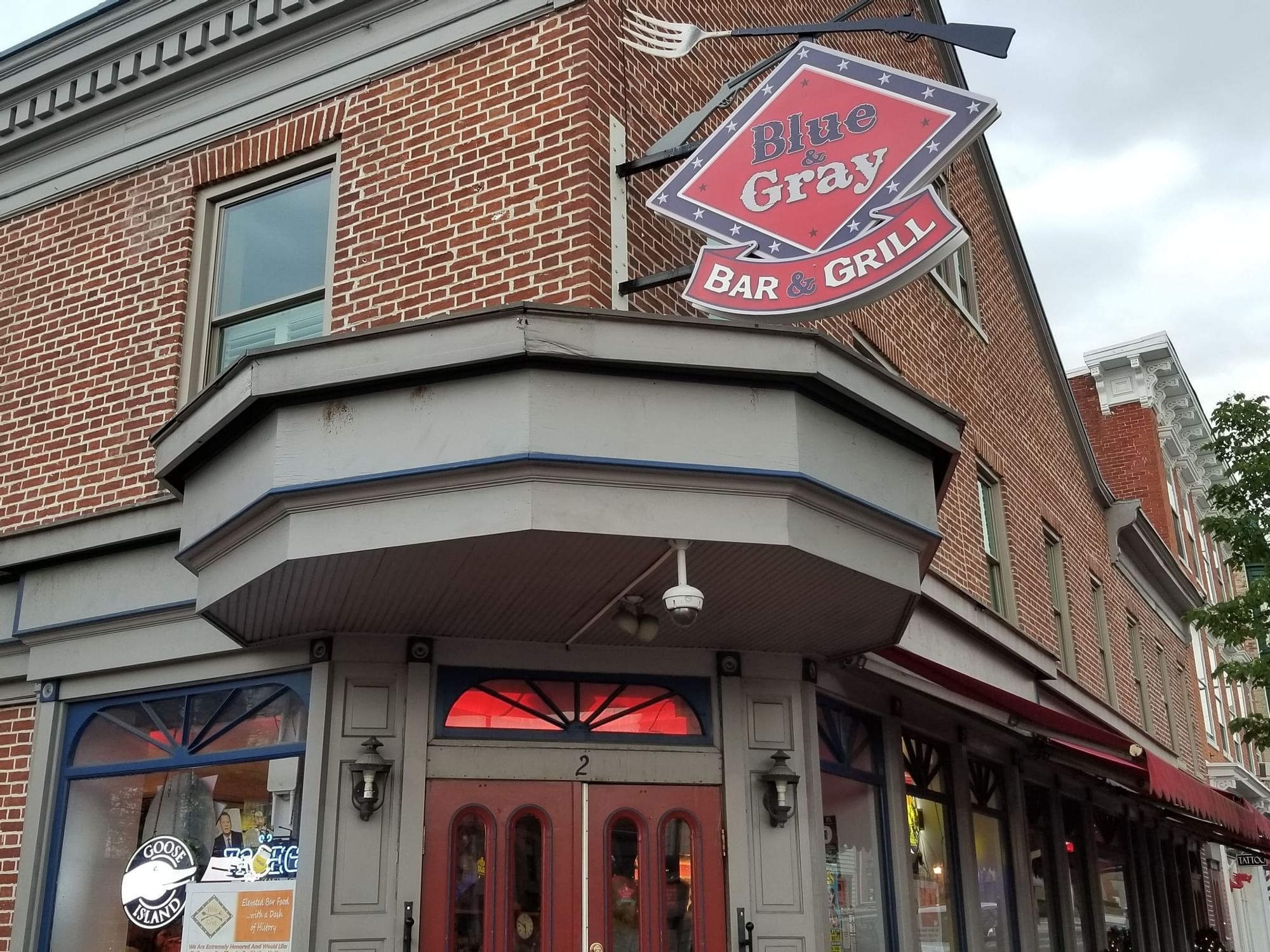 building with sign for blue & gray bar & grill