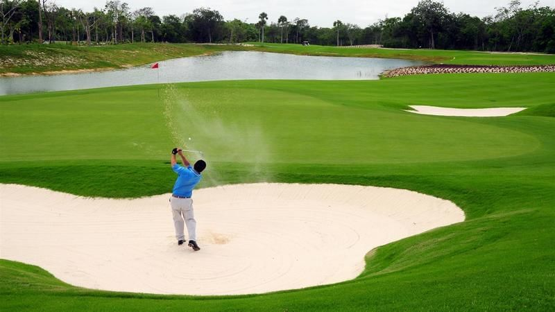 A man playing golf at The Reef Resorts