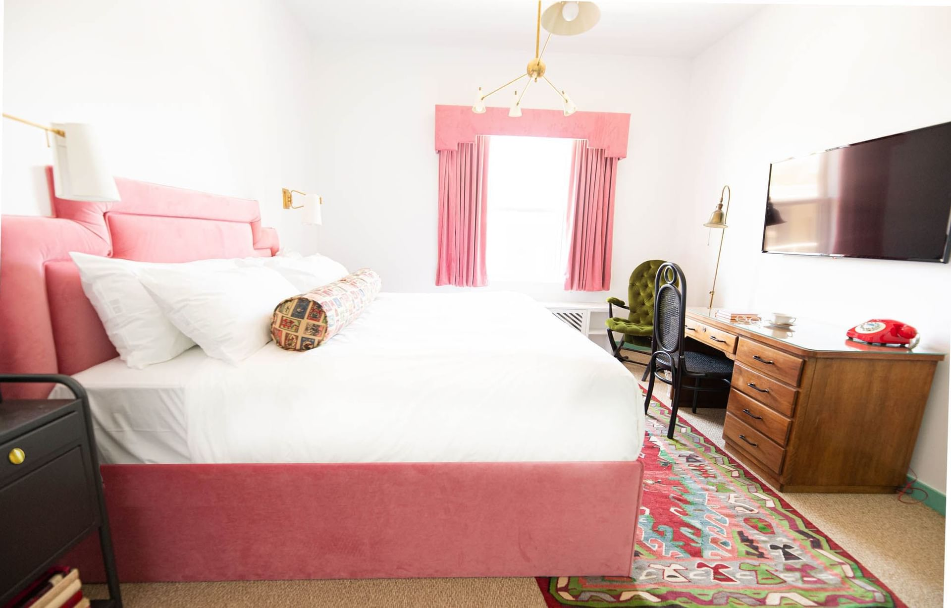 bed with pink bedframe in white room