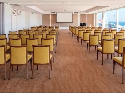 Ballroom with chairs lined up in rows at Noah'S on the beach