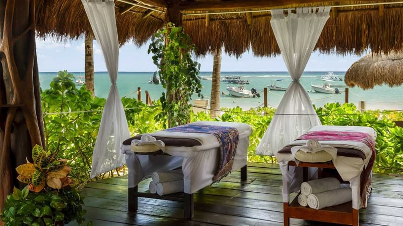 Outdoor spa beds in Ya'ax Spa at The Reef Coco Beach