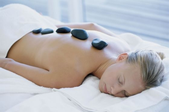 woman relaxing with a hot stone massage