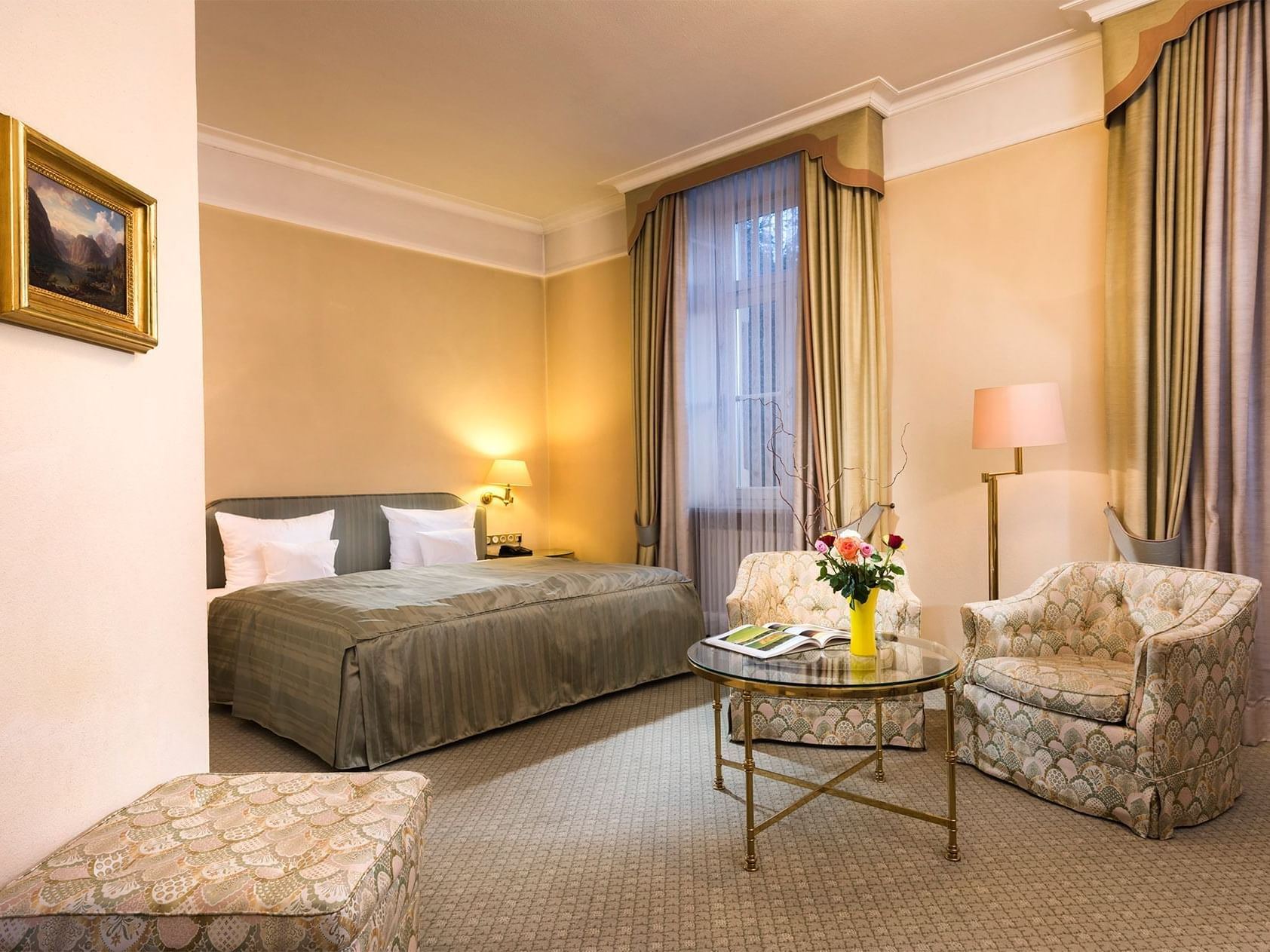 Bed & lounge area of Suite at Precise Bad Reichenhall Bavaria