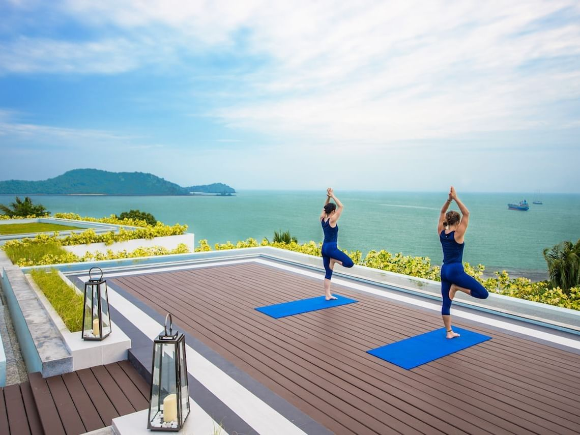 Guests doing yoga on the rooftop