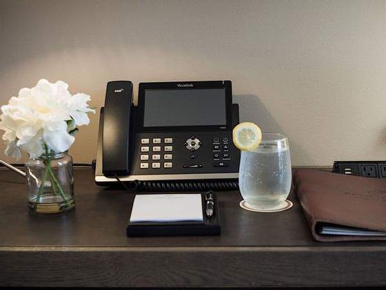 A telephone and other stationery on a table at Hotel Jackson