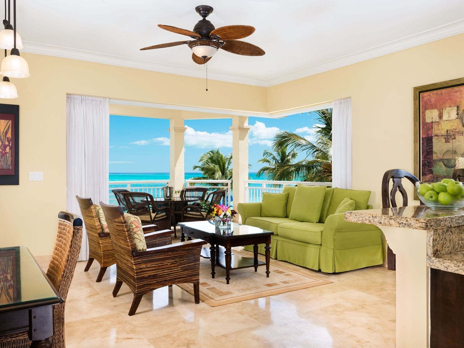 The living room of 2 Bedroom Deluxe Oceanfront at Windsong Resort On The Reef