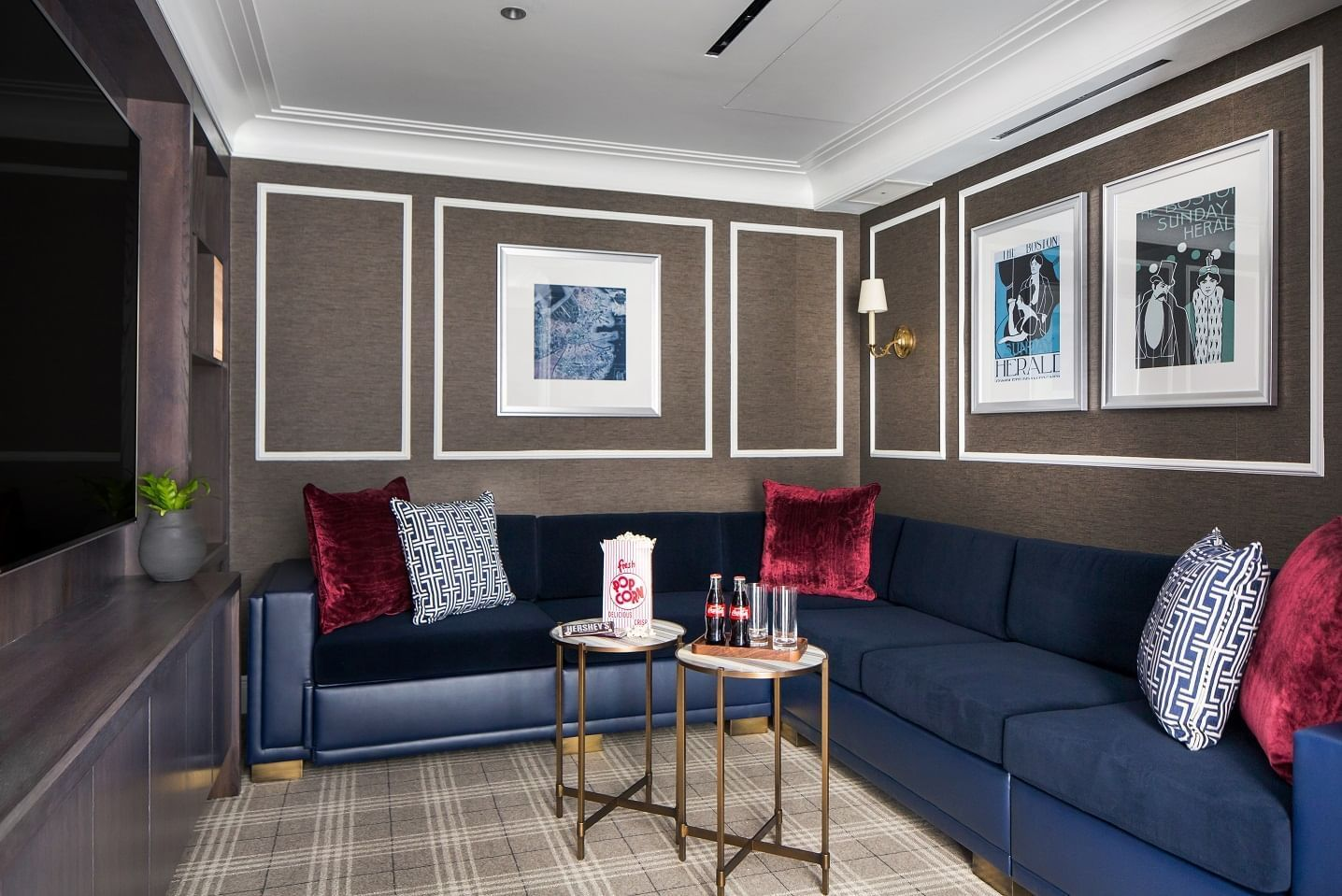 Presidential Suite's media room with couches