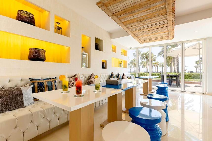 Al Odaid Restaurant Interior with sea view in Sealine Beach Reso