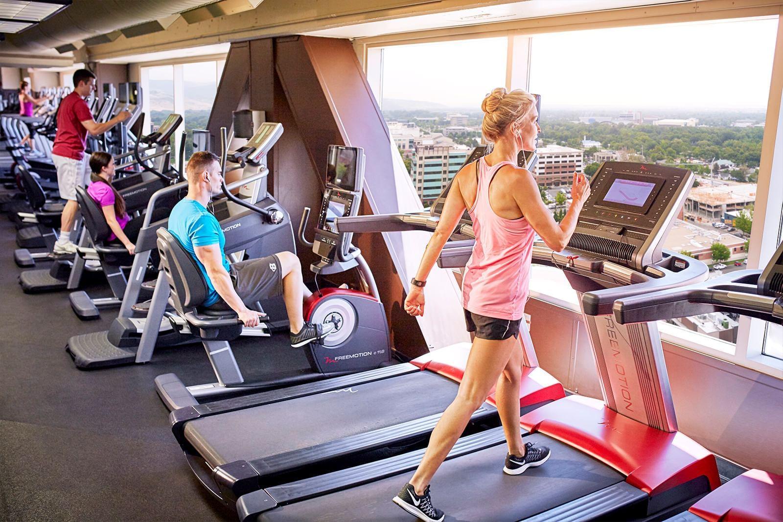 men and women using workout equipment