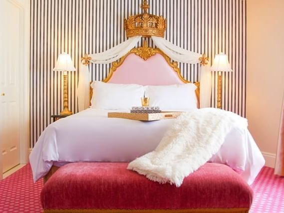 room with large bed and striped wall