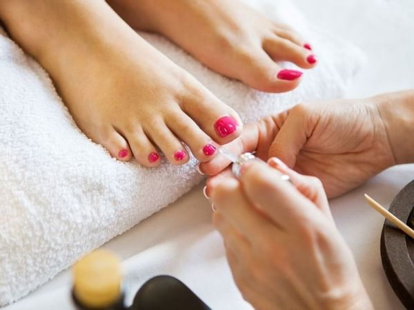 A woman receiving a pedicure at the Spa in Manteo Resort