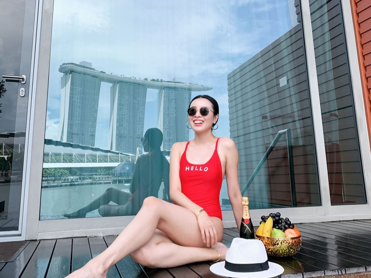 A lady sitting by the pool