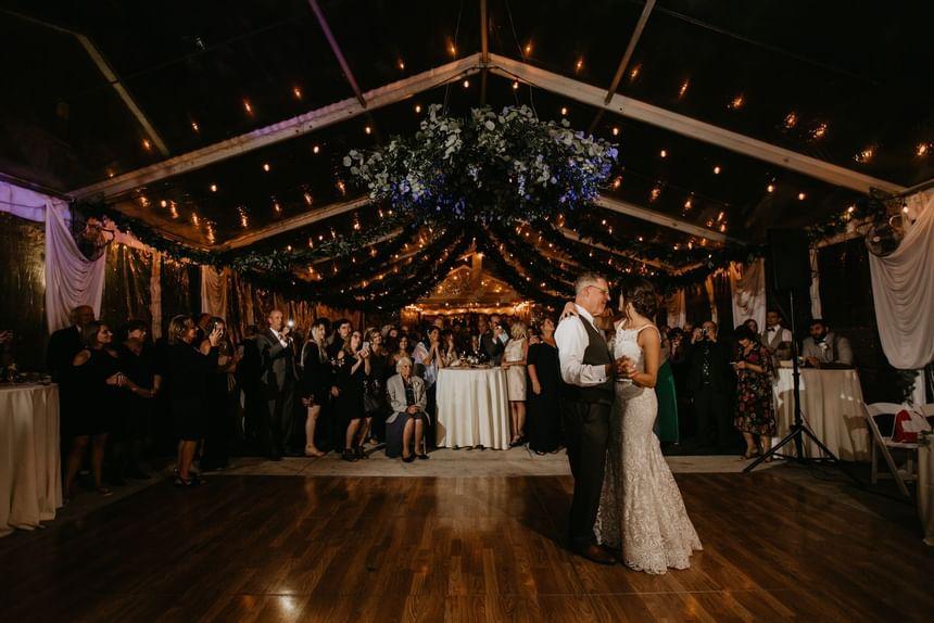 bride and groom dancing at a wedding reception