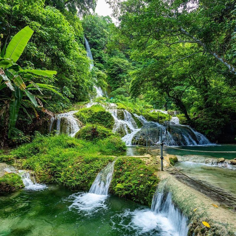 Mele Cascade Waterfalls - WARWICK CORPORATE