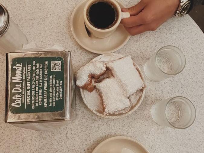 Beignets & coffee served at Café De Monde near La Galerie Hotel