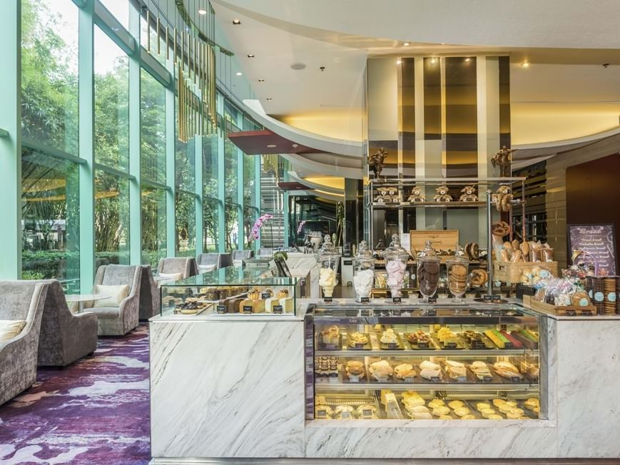Freshly baked goodies with a delicious selection of drinks of Treats gourmet at Chatrium Hotel Riverside Bangkok