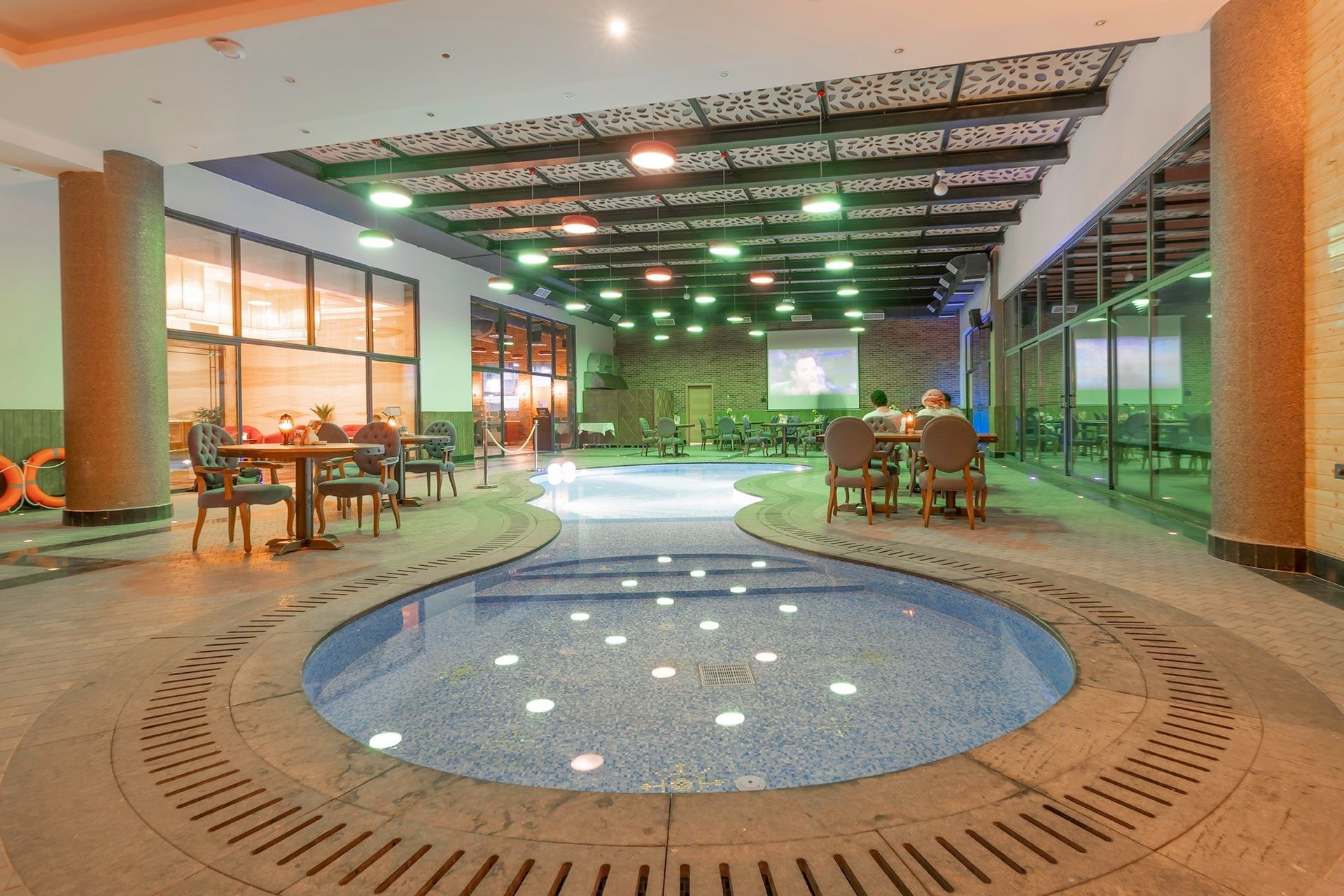 Cafe with pool at Makeen Homes by Warwick