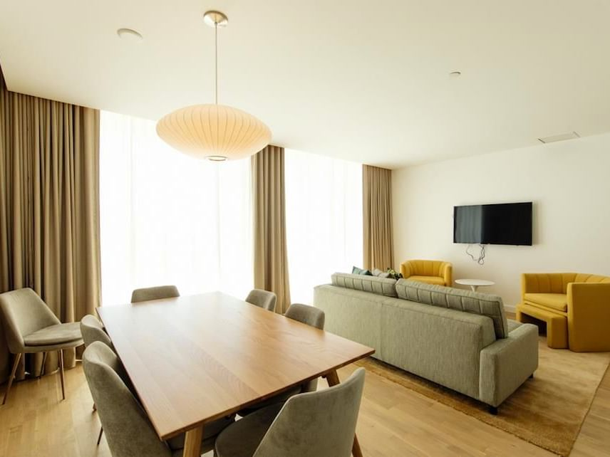 living room and dining room with television on wall