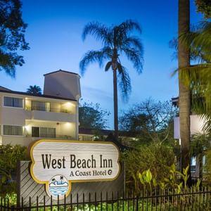 Sign for West Beach Inn, a Coast Hotel