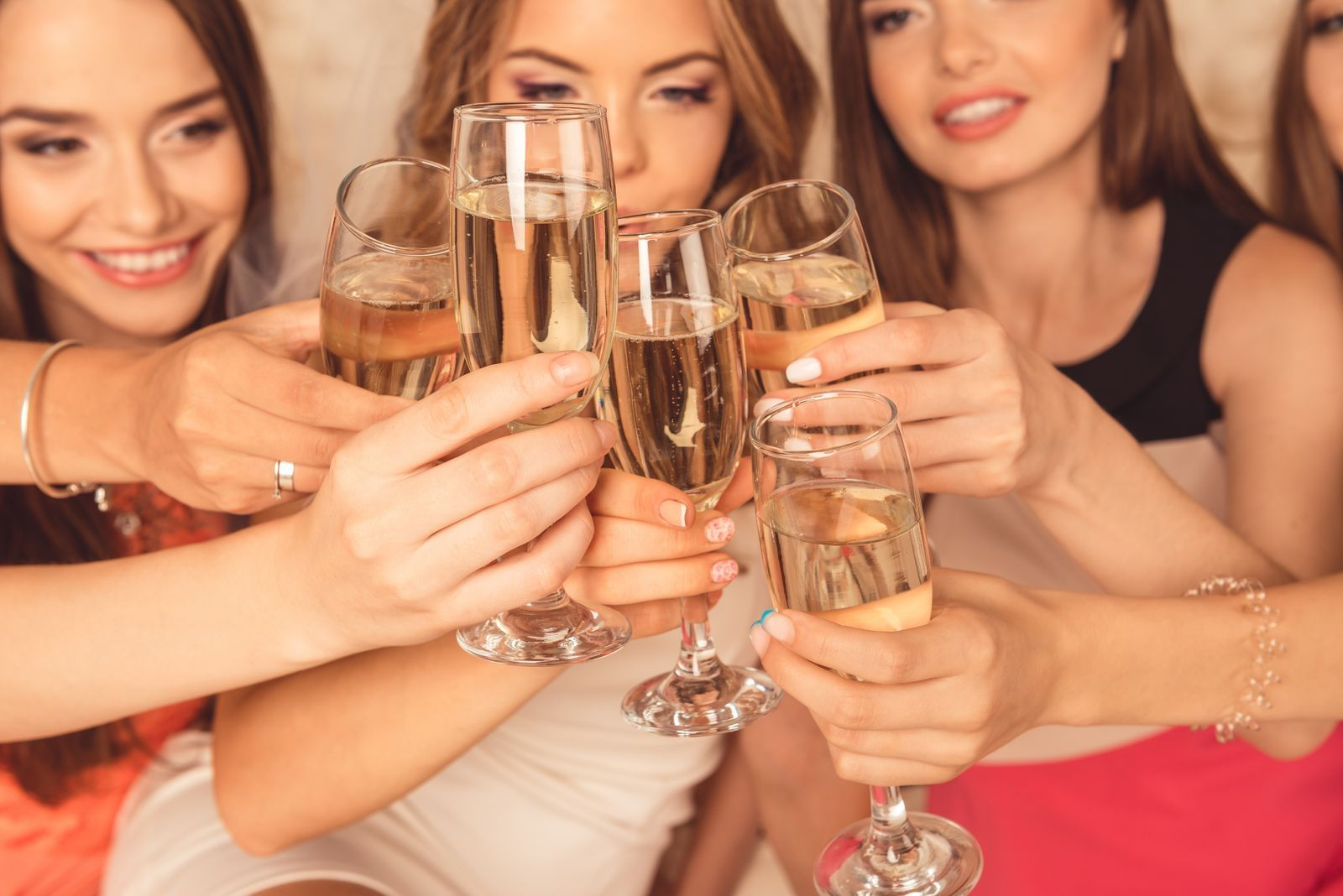 Group of girls toasting with champagne at Carriage House Hotel