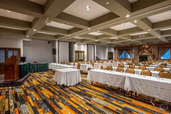 Spacious conference room with tables and wooden podium